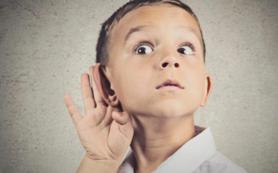 Curious man, boy, listens. Closeup portrait child hearing something, parents talk, hand to ear gesture isolated grey wall background. Human face expression, emotion, body language, life perception